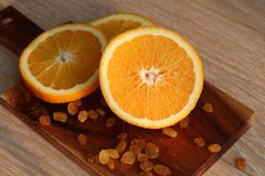 The orange cut on a Board Stock Images