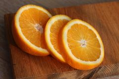 The orange cut on a Board Royalty Free Stock Photo