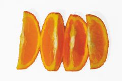 Orange cut in different portions with white background royalty free stock image