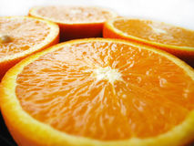Orange cut by fractions Royalty Free Stock Photos