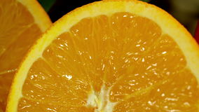 Orange cut in half. Camera moves from left to right. stock video footage