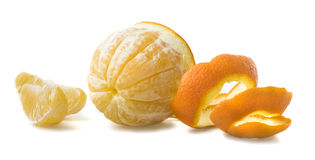 Orange with cut peel. And fresh slice royalty free stock photo