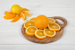 Orange is cut into slices and well decorated on cutting board Royalty Free Stock Images