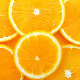 Orange cut into wedges Stock Image
