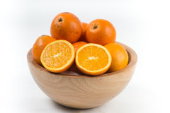 Orange cut in wooden bowl Royalty Free Stock Photo