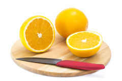 Orange on cutting board Royalty Free Stock Photo
