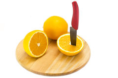 Orange on cutting board Stock Image