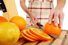 Orange cutting closeup Stock Images