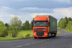 Orange DAF Semi Truck Transport at Spring Stock Images