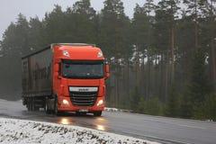 Orange DAF XF Semi on Wet Road Royalty Free Stock Photography