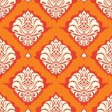 Orange Damasttapete Stockfotografie