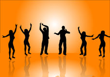 Orange Dancers. A group of dancers in silhouette on a stage in front of an orange background with a white light in the centre. With reflections of the dancers on Royalty Free Stock Photo