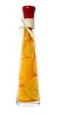 Orange dans une bouteille Photo libre de droits