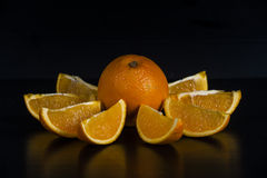 Orange in dark on black Royalty Free Stock Photography