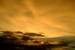 Orange and dark clouds on sky. Stock Image
