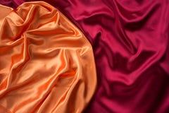 Orange and dark red satin textile Royalty Free Stock Photos