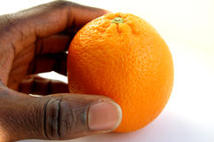 Orange days. This is an image of a hand with an orange. This is a metaphor for fruitful, success, harvest etc royalty free stock image