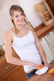 Orange de serrage de l'adolescence Photographie stock