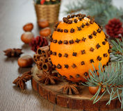 Orange decorated with cloves stock photo