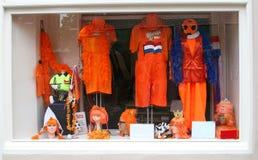 Orange stuff for sale for Kingsday (Koningsdag),Amersfoort, Netherlands. Shop in Amersfoort with orange suits, hats, trousers, pants and crowns for Kingsday ( Stock Image