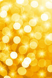 Orange defocused lights with stars useful as a background. Good for website designs or texture. Royalty Free Stock Photography