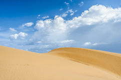 Desert shapes with peacefull blue sky. Orange desert with peacefull blue sky from Muie Ne Vietnam Stock Image