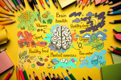 Orange desktop with brain sketch. Top view of orange desktop with healthy brainstorm sketch and supplies. Food for brain concept Royalty Free Stock Images