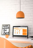 Orange desktop with laptop showing e-learning website Stock Photo