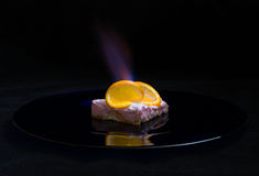 Orange dessert with fire stock photos