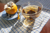 Orange dessert and  glass cap of tea with golden teaspoon Royalty Free Stock Photos