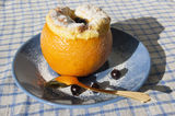 Orange dessert and  golden teaspoon Royalty Free Stock Image