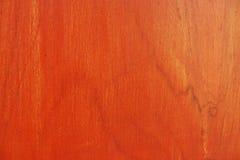 Orange detalj för färgnaturmodell av teakträträ Arkivfoto