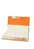 Orange diary Stock Photos