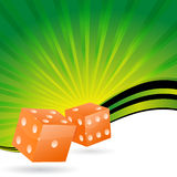 Orange dice with shiny green background Stock Image