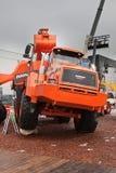 Orange diesel excavator and lorry Stock Photo