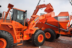 Orange diesel front end loader Stock Images