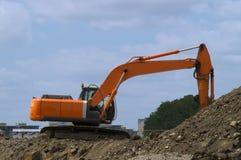 Orange digger Royalty Free Stock Photo