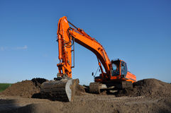 Orange digger Royalty Free Stock Photo