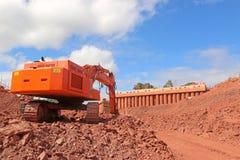 Digger on a construction site stock photos