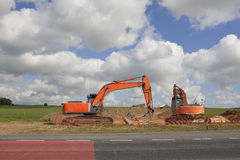 Orange diggers Stock Image