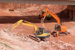 Diggers on a construction site royalty free stock photography