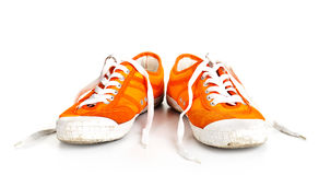 Orange dirty shoes isolated Royalty Free Stock Image