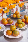 Orange on dish in chinese shrine for making merit. Royalty Free Stock Photos