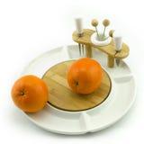 Orange on plate. Oranges on a white china fruit dish Royalty Free Stock Photo