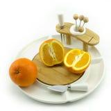 Orange on plate. Oranges on a white china fruit dish Royalty Free Stock Photography