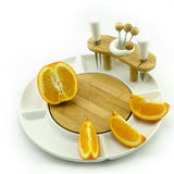 Orange on plate Stock Images