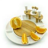 Orange on plate. Oranges on a white china fruit dish Stock Images