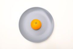 Orange in a dish Stock Photography