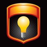 Orange display with a light bulb Stock Photos