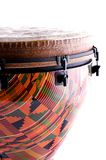 Orange Djembe Drum Isolated. An orange djembe drum isolated against a high key or white background in the vertical or portrait view Stock Photo